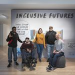 5 smiling people stand and sit in front of a large poster that reads 'Inclusive Futures'